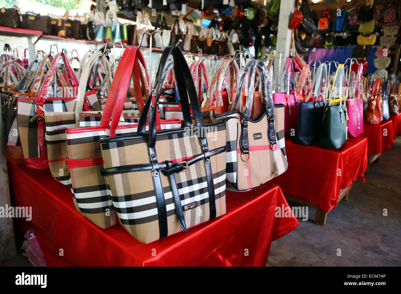 6274203e9c99 Fake designer bags and branded goods in Donsao Island village in Laos at  the Golden Triangle