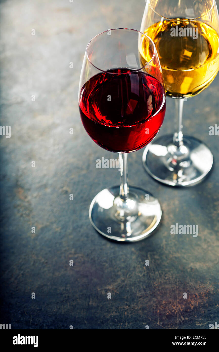 Food background with Glasses of white and red wine - Stock Image
