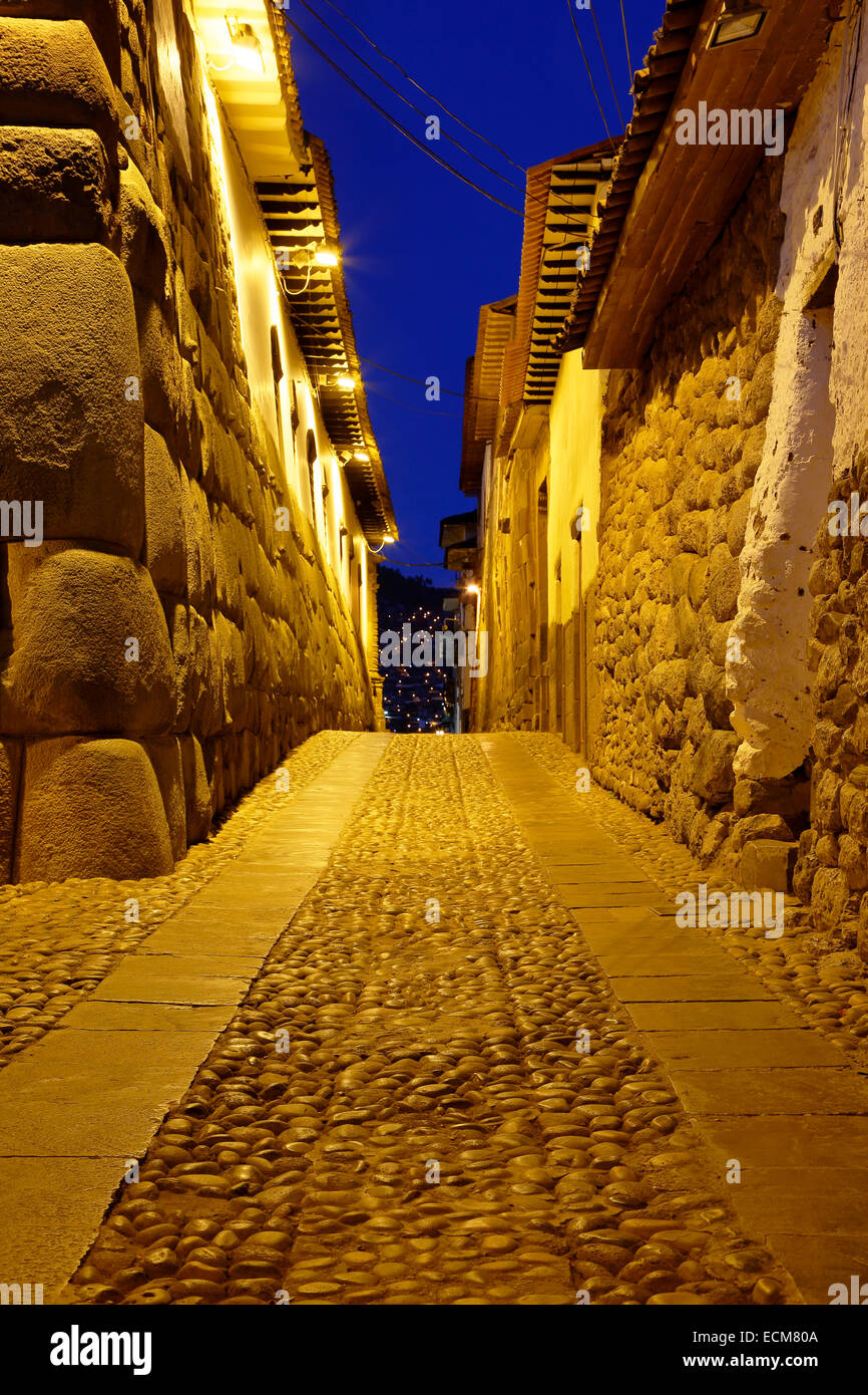 Inca stone walls and cobbled street, Cusco, Peru - Stock Image
