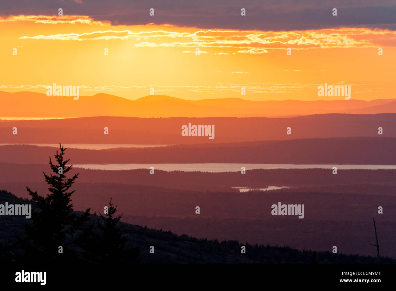 The view to the west at sunset from the summit of Cadillac Mountain in Acadia National Park, Maine. Stock Photo