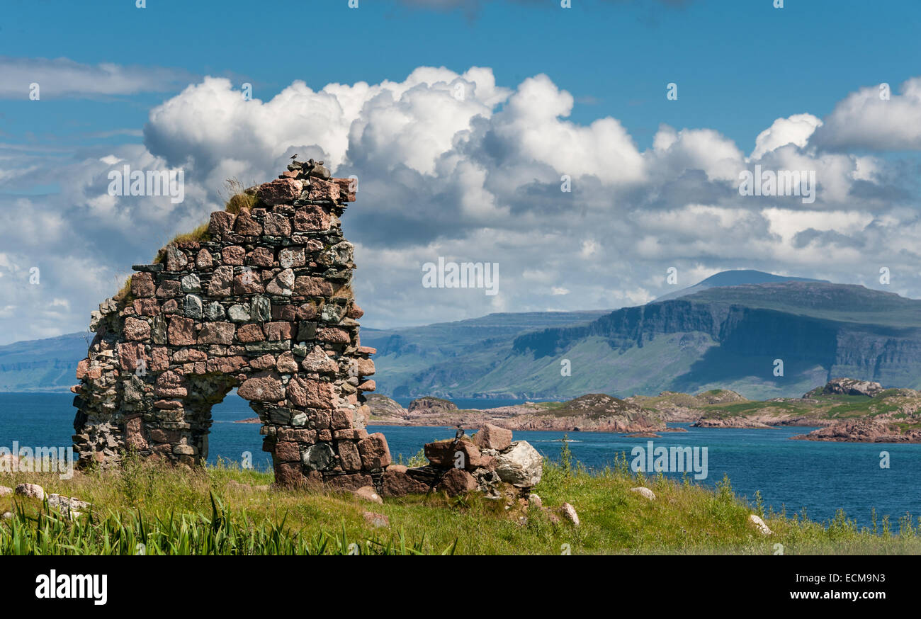 A view from the island of Iona back towards Mull in Scotland's Western Isles with a ruined wall in the foreground. Stock Photo