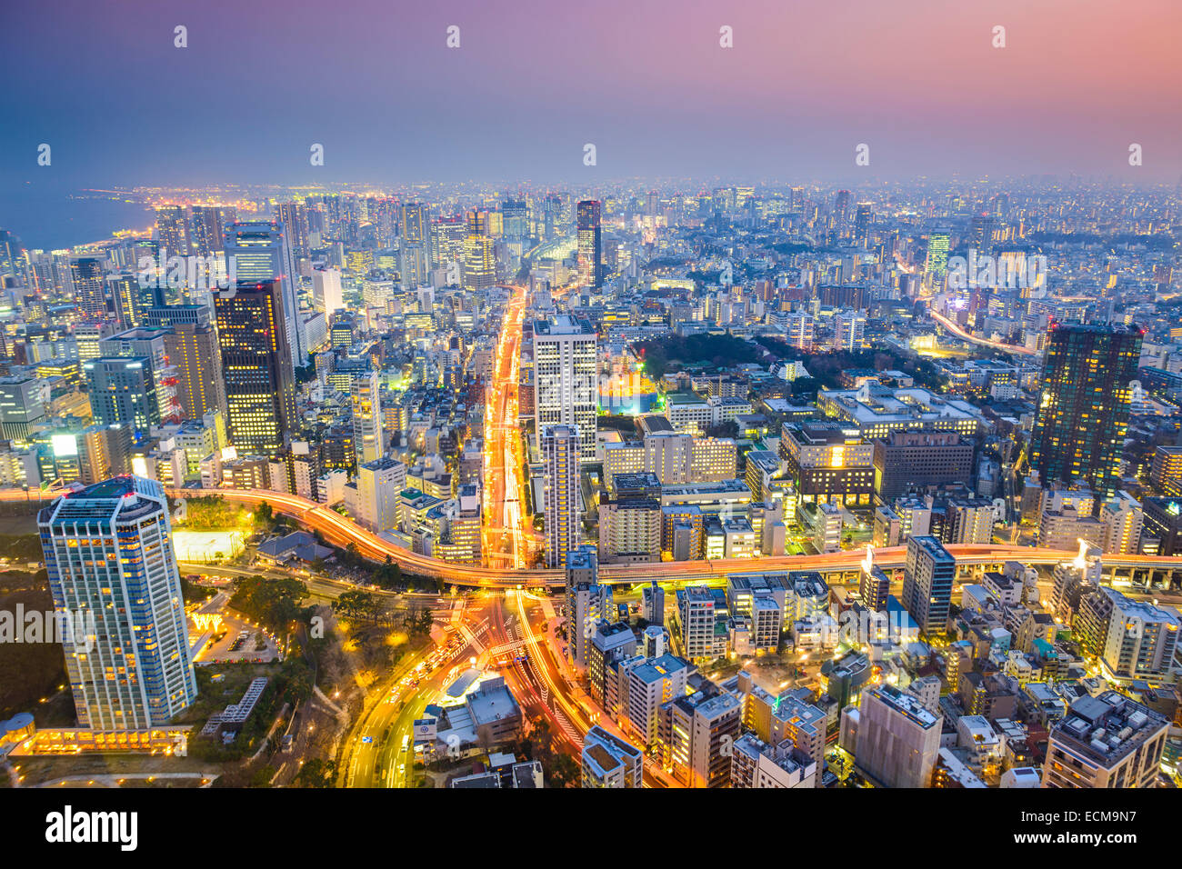 Tokyo, Japan cityscape at dusk above highway junction. Stock Photo