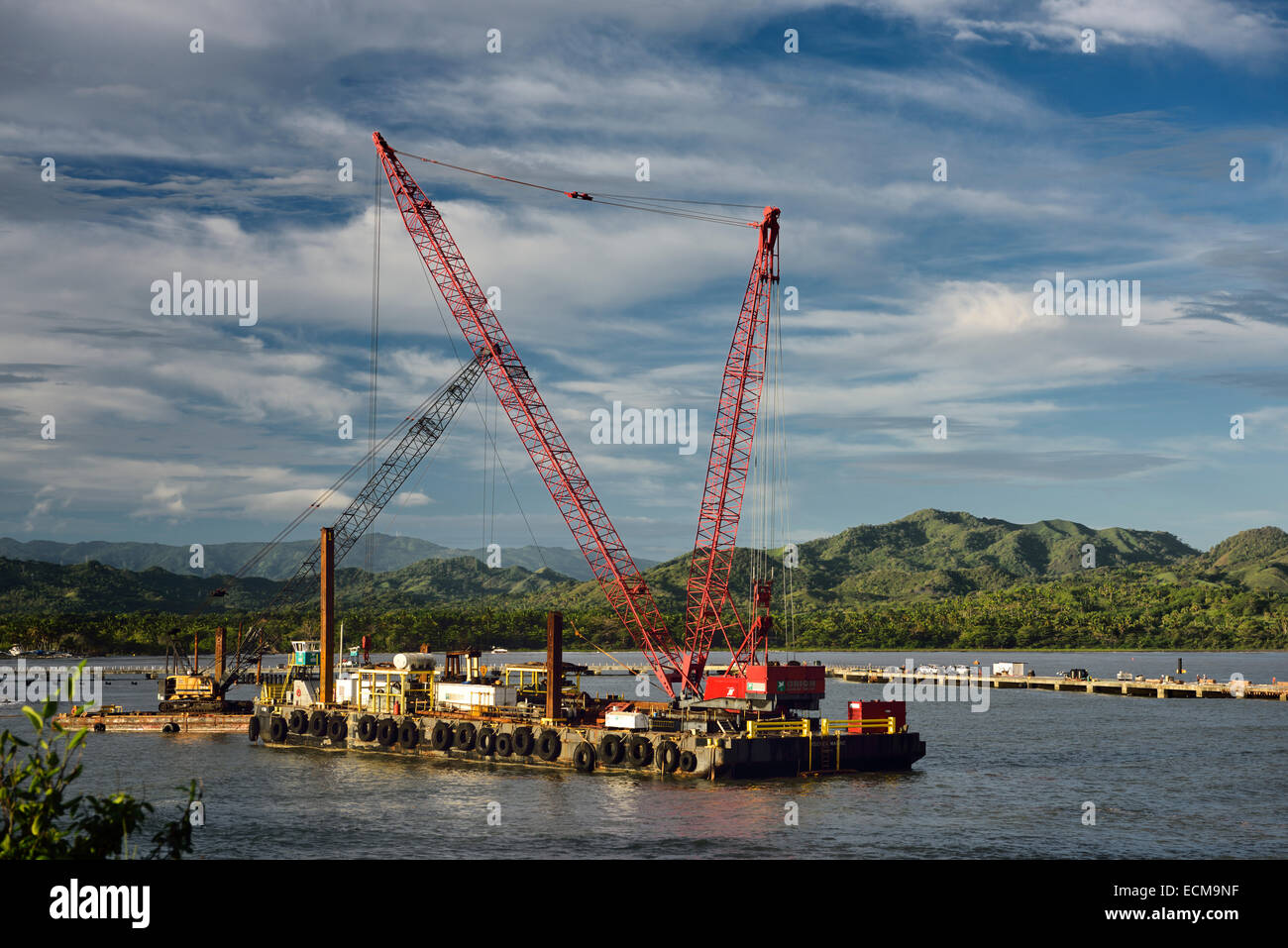 Crane barge constructing new cruise ship terminal in Maimon Bay near Puerto Plata Dominican Republic - Stock Image