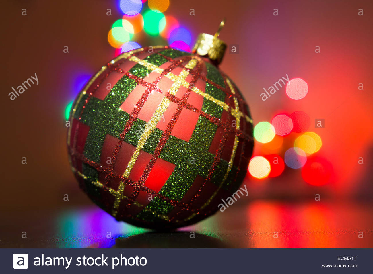 X-mas tree decor with background of blurry lights - Stock Image