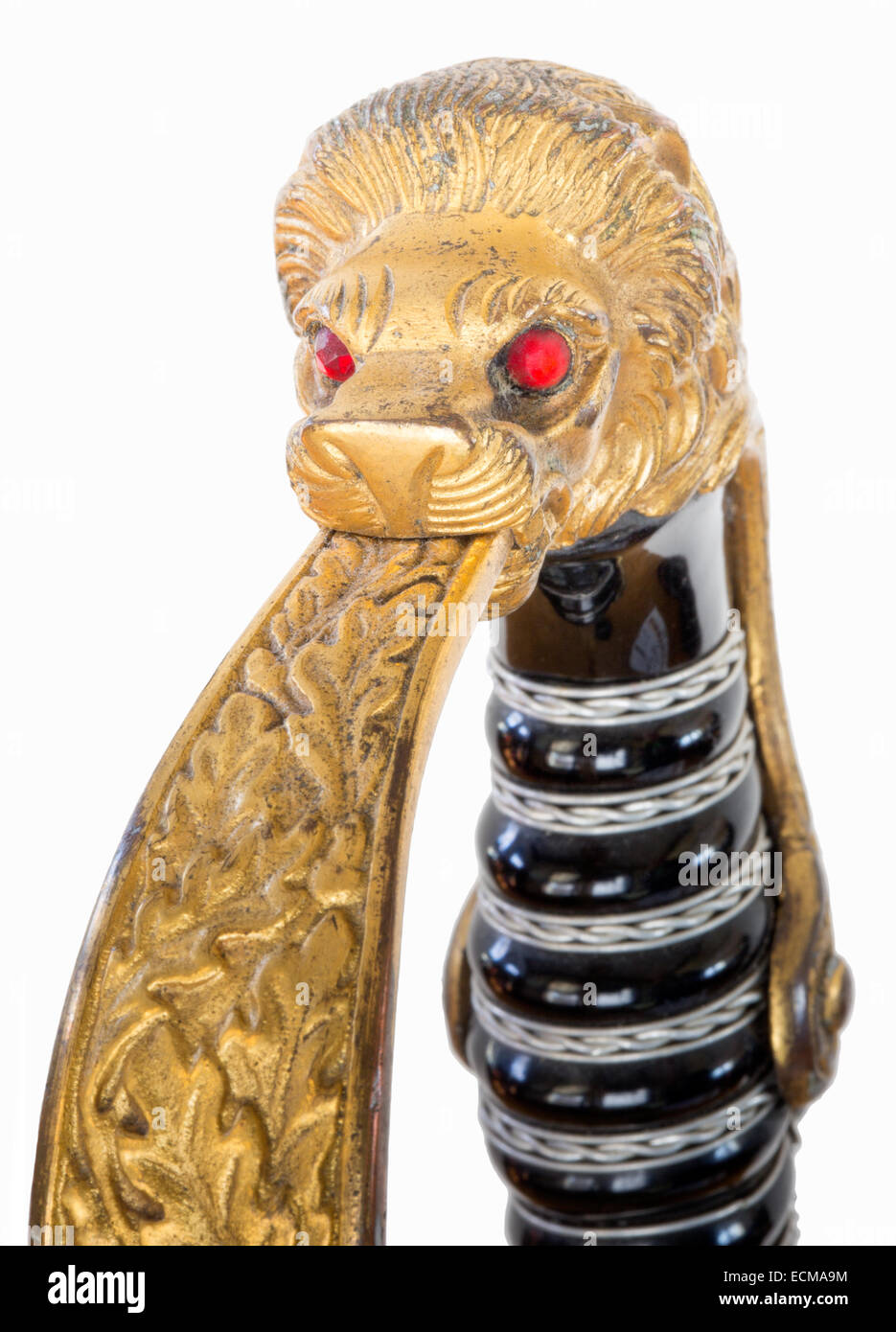 Close up detail of a 1940s WWII Nazi military army dress sword with a lion's head pommel with red glass eyes - Stock Image