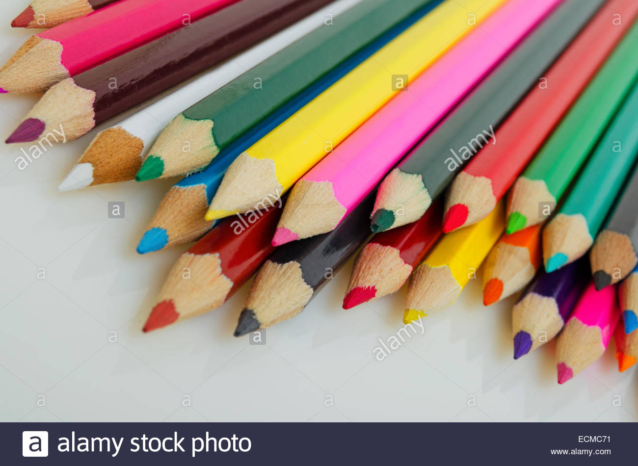 Colored pencils on a light background closeup. - Stock Image