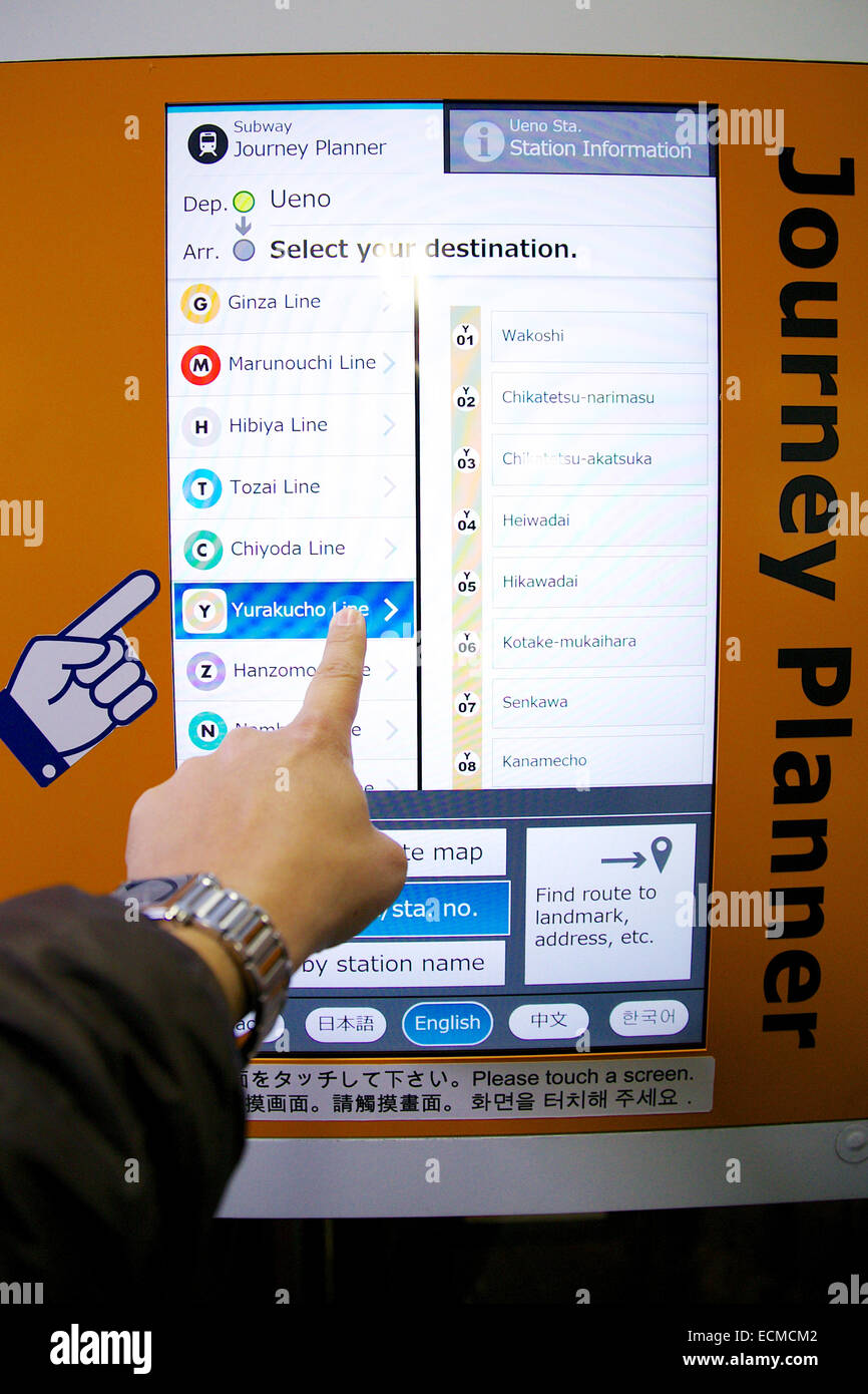 a man uses a subway information touch panel guide journey planner