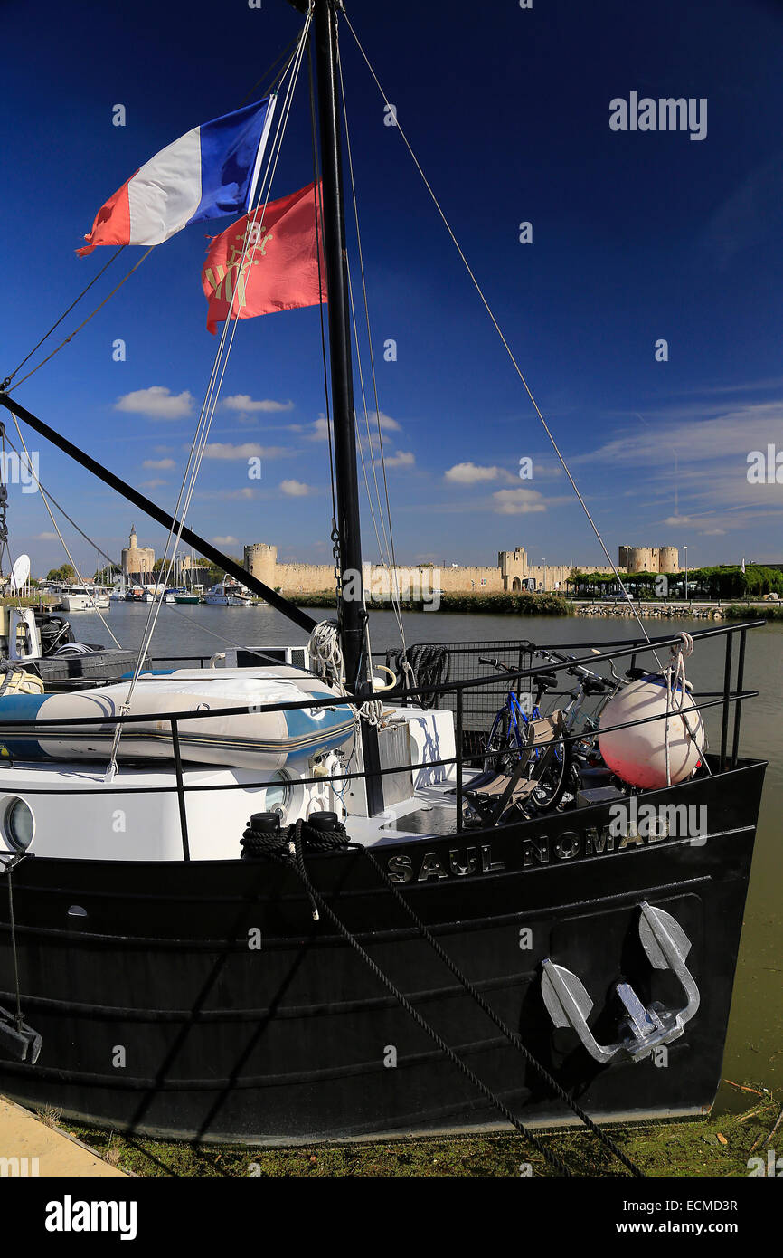 Sailing boat on the Camargue showing French flag. - Stock Image