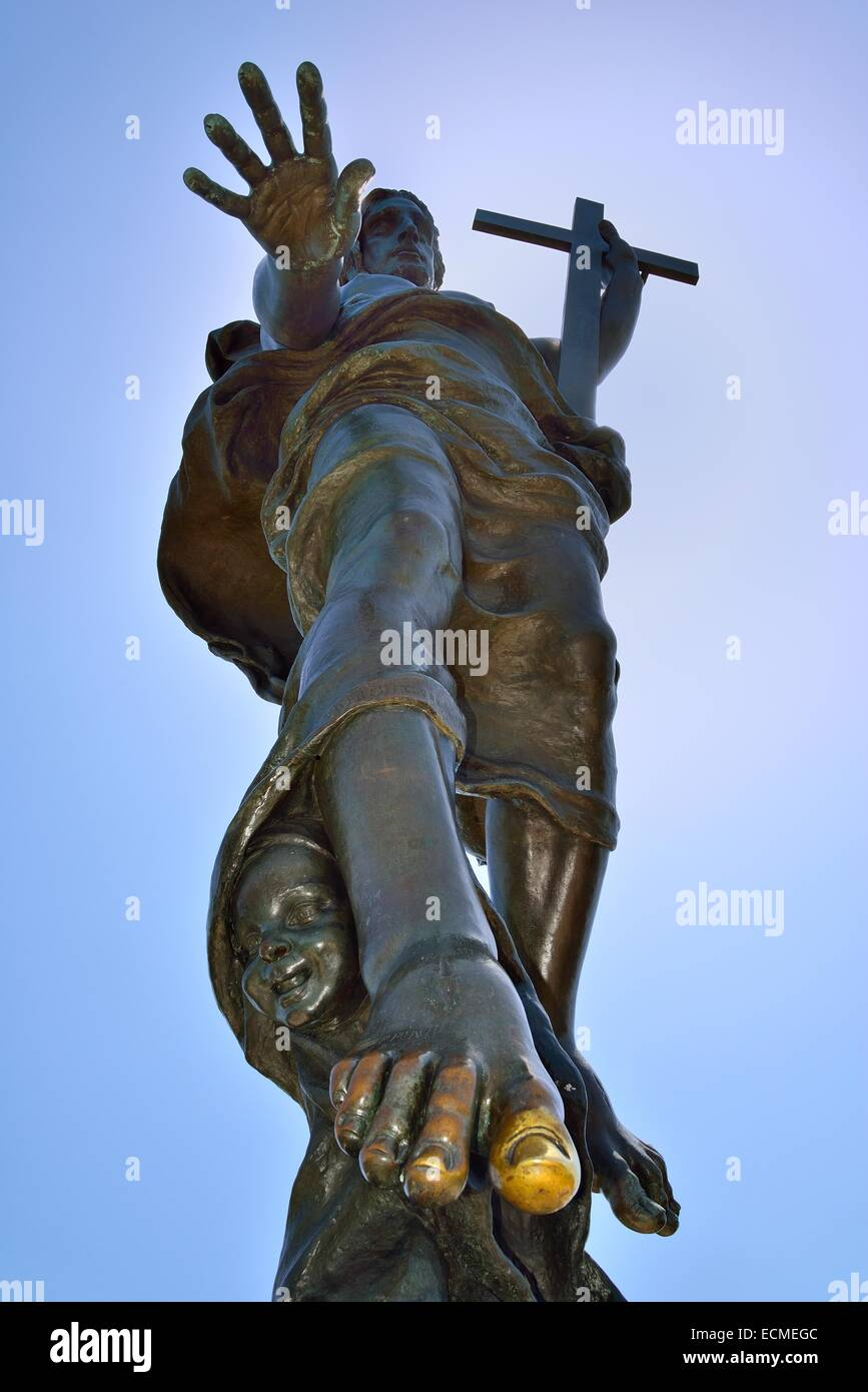 Bronze statue of the Redeemer, lucky toe, used and golden, Nuoro, Ortobene, Nuoro, Sardinia, Italy - Stock Image