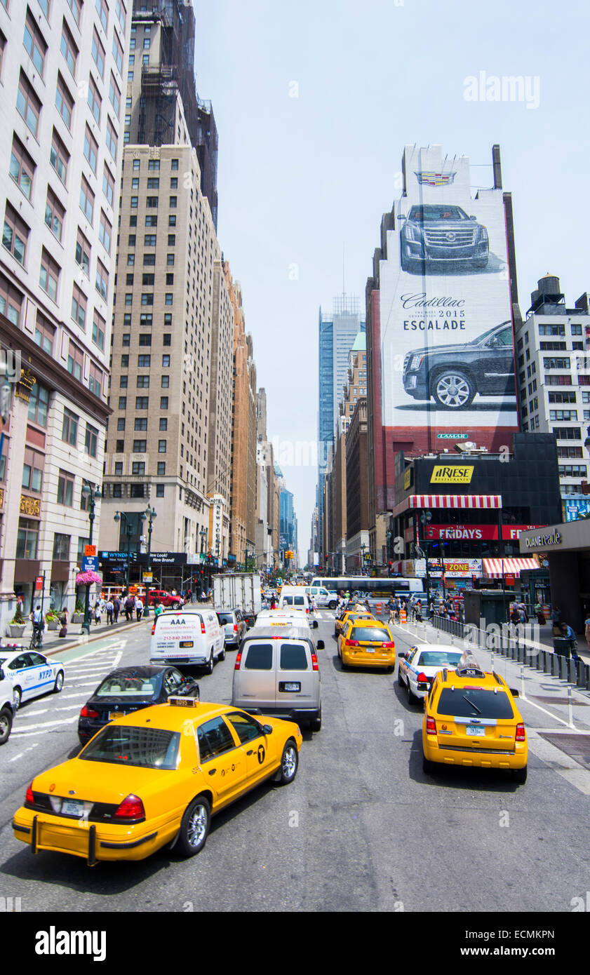 New York City New York busy 34th Street  with traffic and people in downtown Manhattan rush Macys shopping - Stock Image