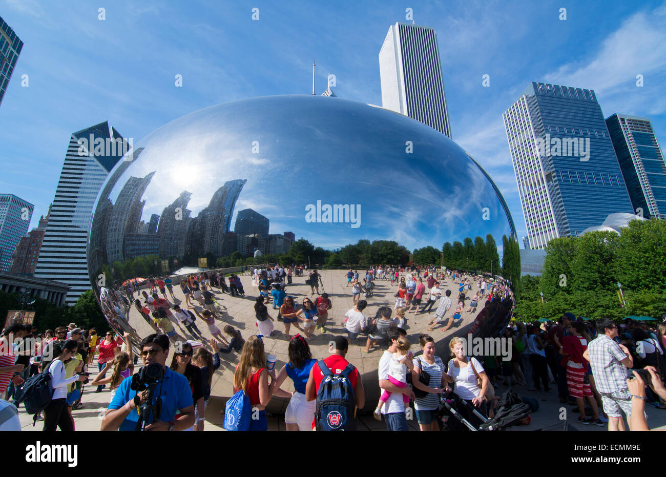 Chicago Illinois Millennium Park with famous Cloud Gate sculpture called The Bean with skyline in background skyscrapers - Stock Image