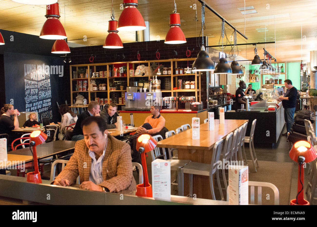 Oslo Norway Peppes Pizza a modern pizza restaurant with WiFi and customers dining - Stock Image
