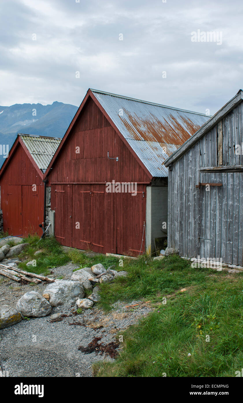Norway cruise Hurtigruten beautiful little town of 43 people  three old barns  in Hjorundjorden area of Norway - Stock Image
