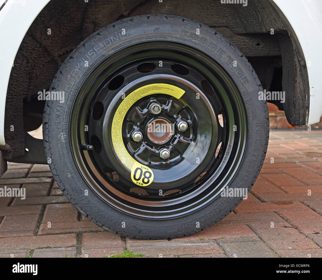 Compact space saver spare wheel fitted to a Hyundai i10 (62 reg) - Stock Image