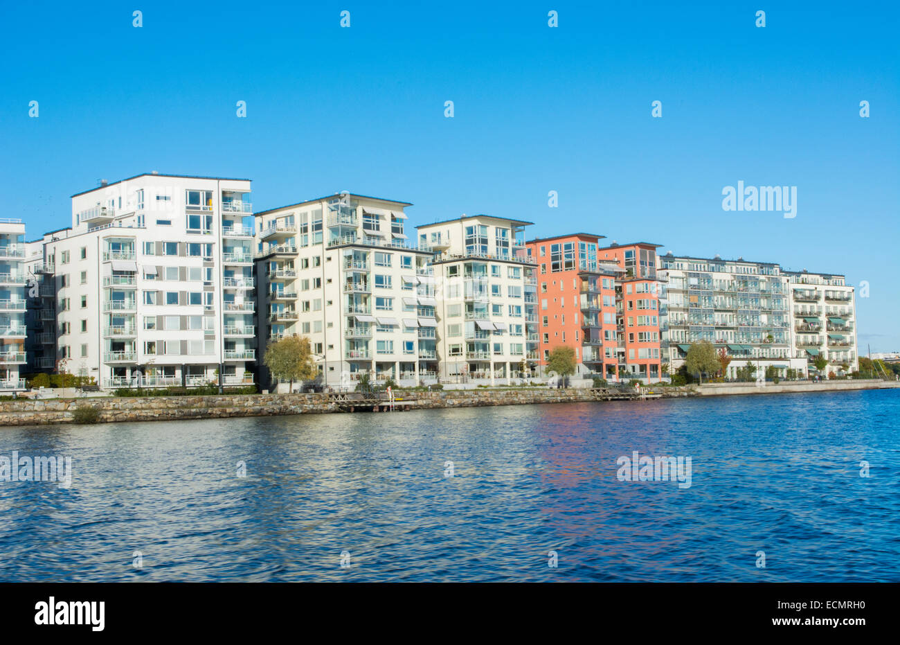 Stockholm Sweden modern apartments on water in suburbs from cruise ship - Stock Image