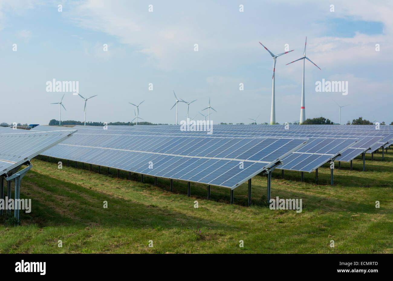 Germany wind energy turbines and solar panels ecology in field near Hamburg green - Stock Image