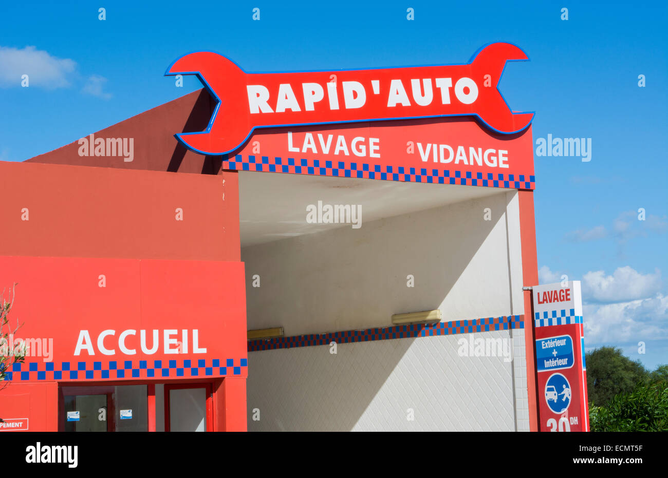 Rabat Morocco  colorful car wash and oil change with wrench in French language - Stock Image