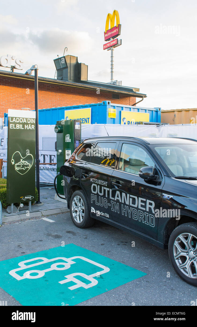 Stockholm Sweden McDonalds Electric car charge lane auto green ecology Electric Car - Stock Image
