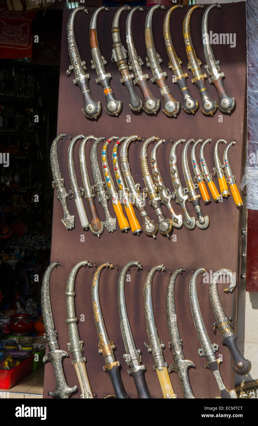 Marrakech Morocco main medina selling knives to tourists downtown city - Stock Image