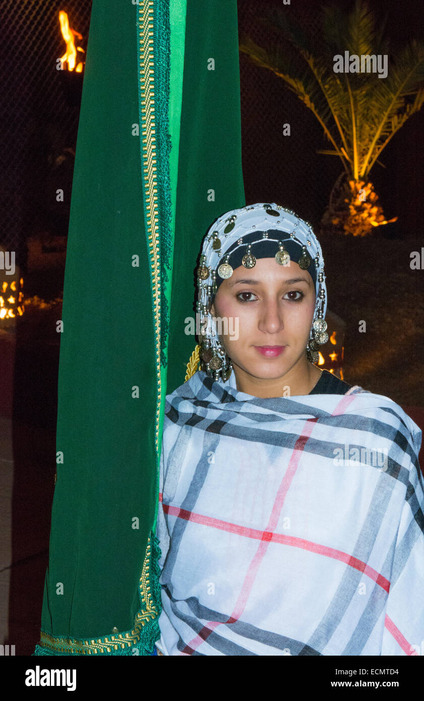 Marrakech Morocco beautiful woman in costume in Chez Ali show place - Stock Image