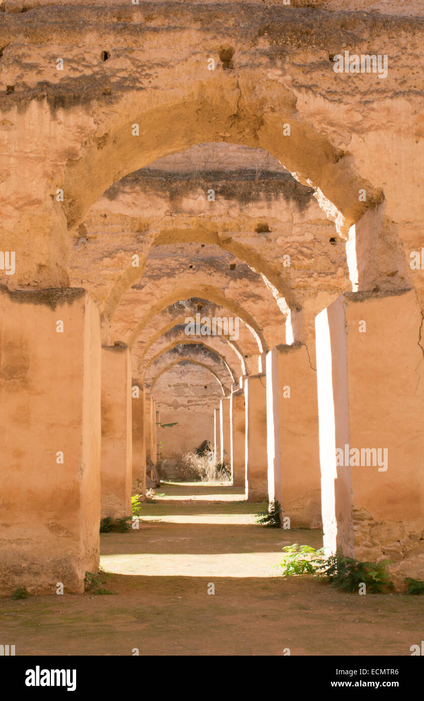 Meknes Morocco columns of Hri Souani former horse stalls in 17th century in downtown with sunlight - Stock Image
