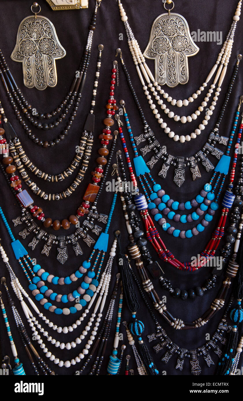 Meknes Morocco main square of city medina art work necklaces for sale to tourists - Stock Image