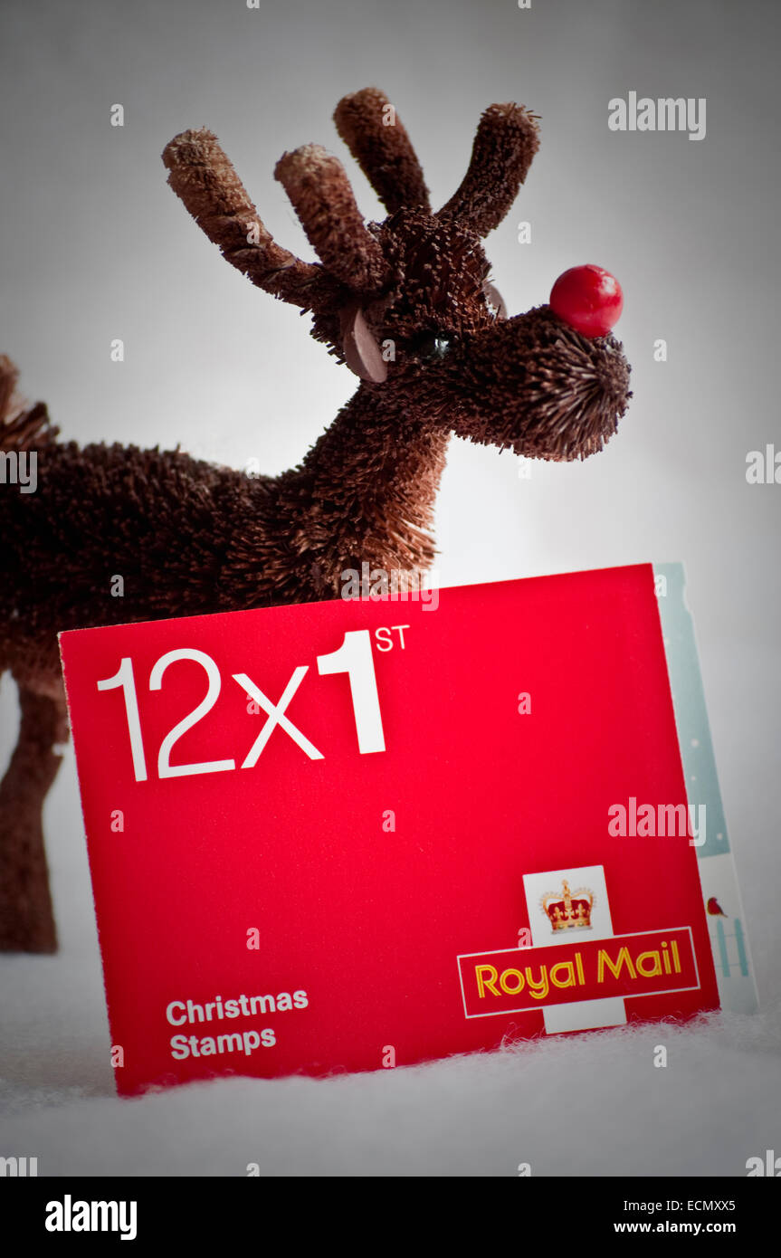 12 x first /1st Class UK delivery booklet. Christmas Stamps for cards and letters to be  posted in time for Xmas.. - Stock Image