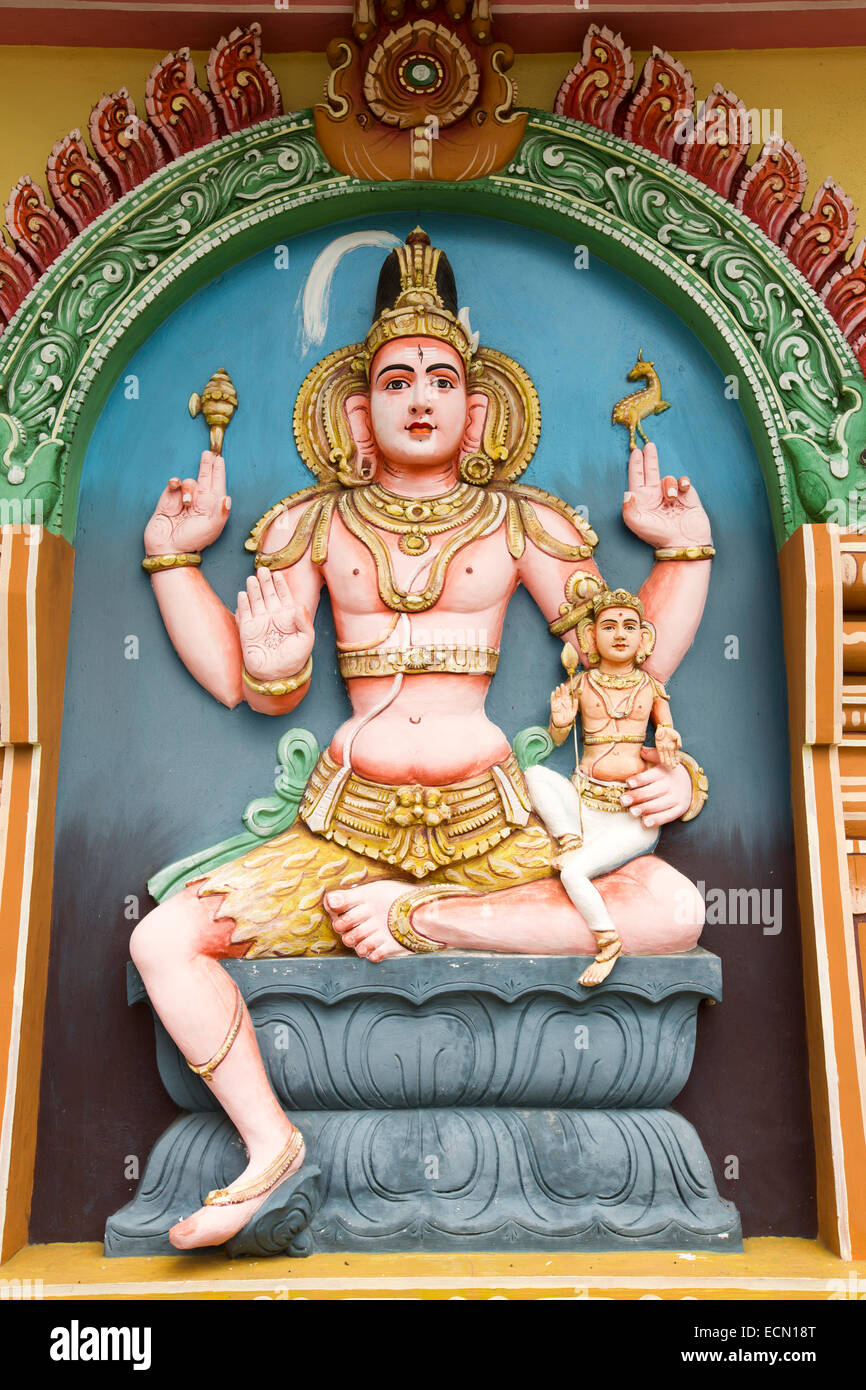Mauritius, Mahebourg, Hindu temple, colourfully painted statue of shiva with axe and deer - Stock Image