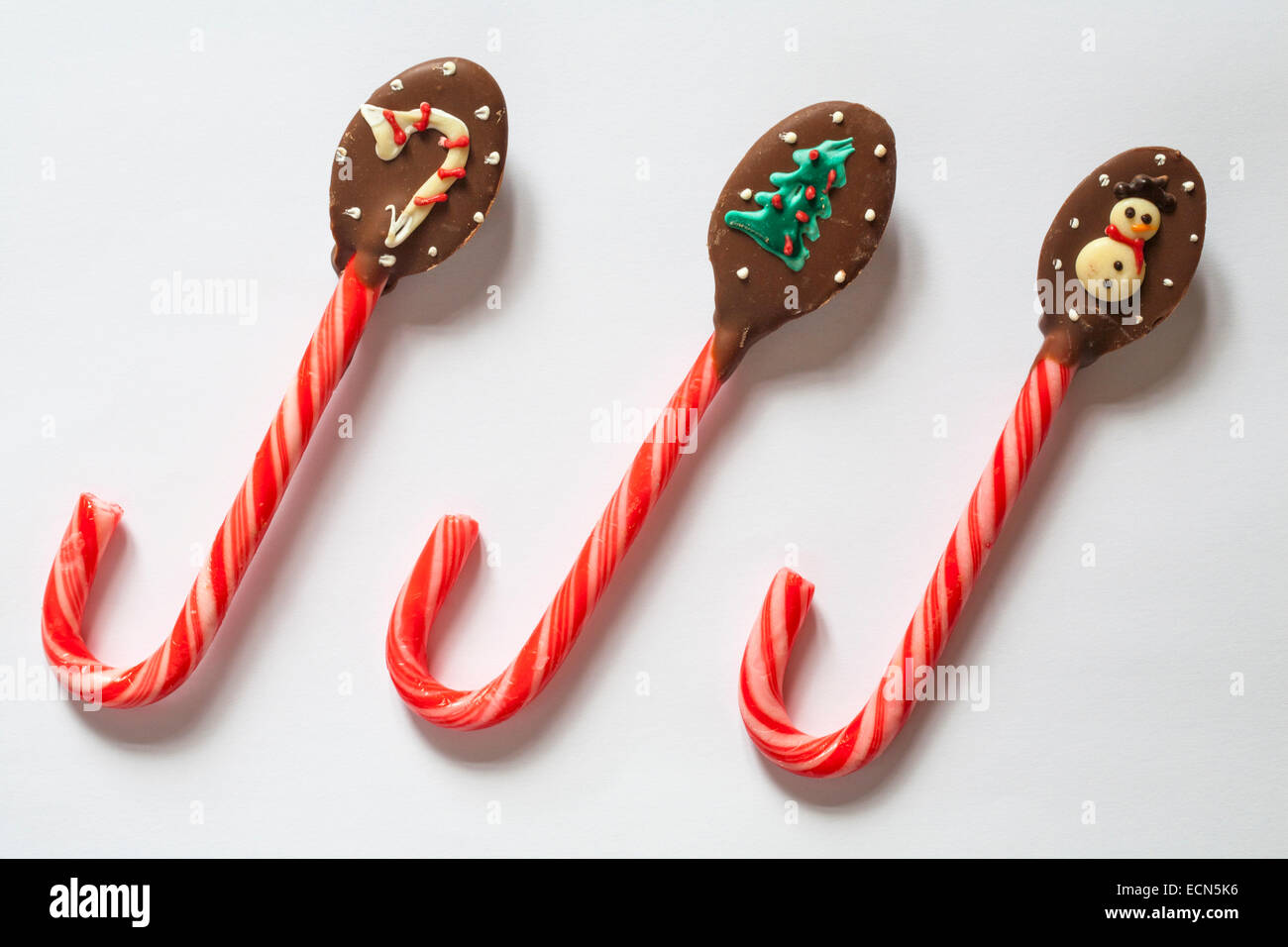 chocolate dipped candy cane with decorated with christmas themes
