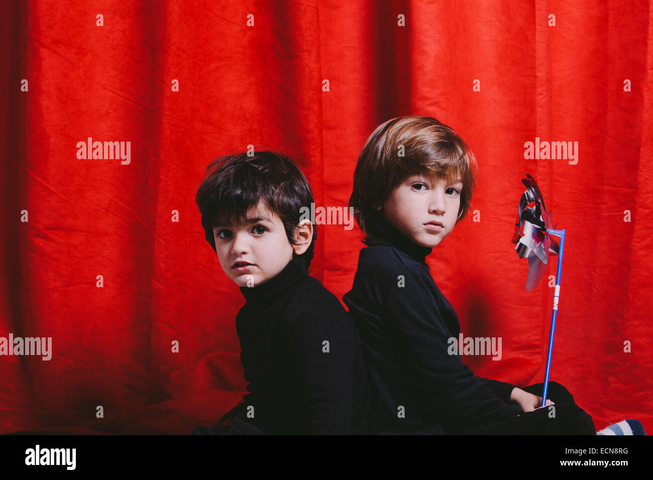 Studio portrait of two boys wearing black clothes - Stock Image