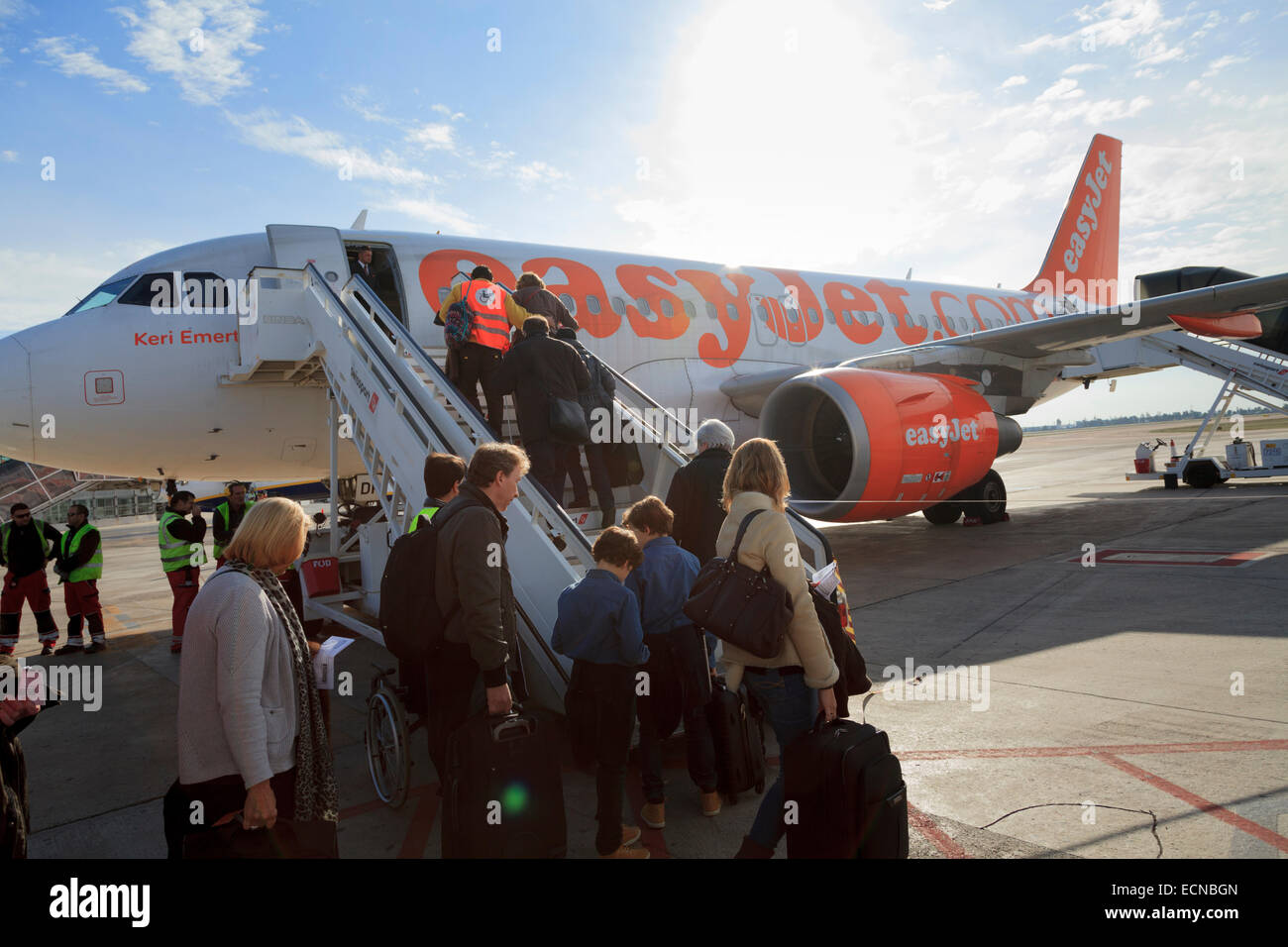 Passengers using the front aircraft stairs to board an Easyjet aircraft Stock Photo