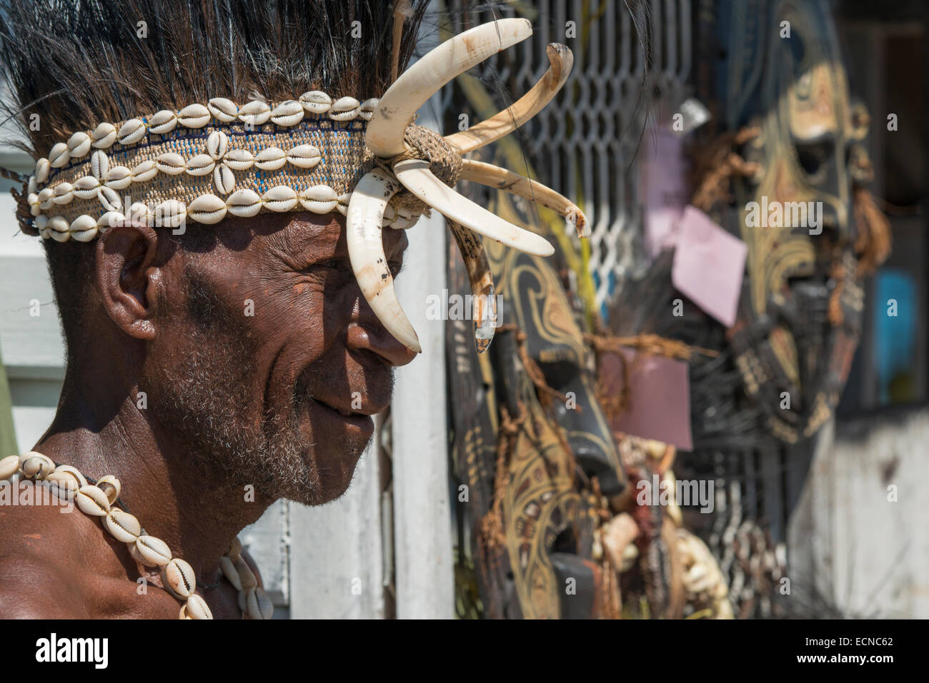 Melanesia, Papua New Guinea. Village of Vanimo. Traditional welcome sing-sing with villagers in native attire. Village - Stock Image
