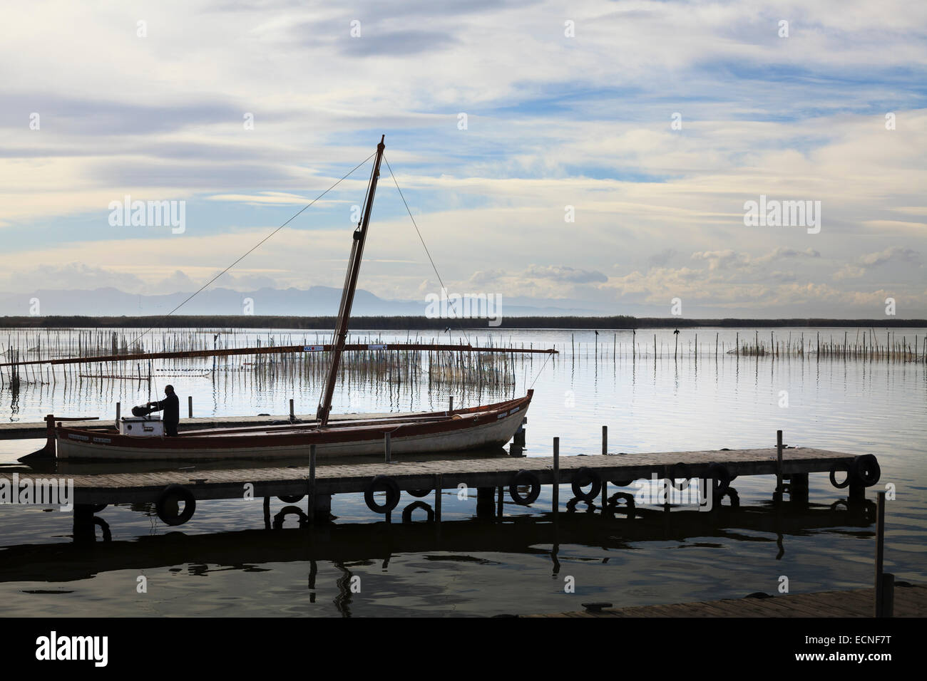 Sailing boat being prepared on the jetty on Lake Albufera Spain - Stock Image