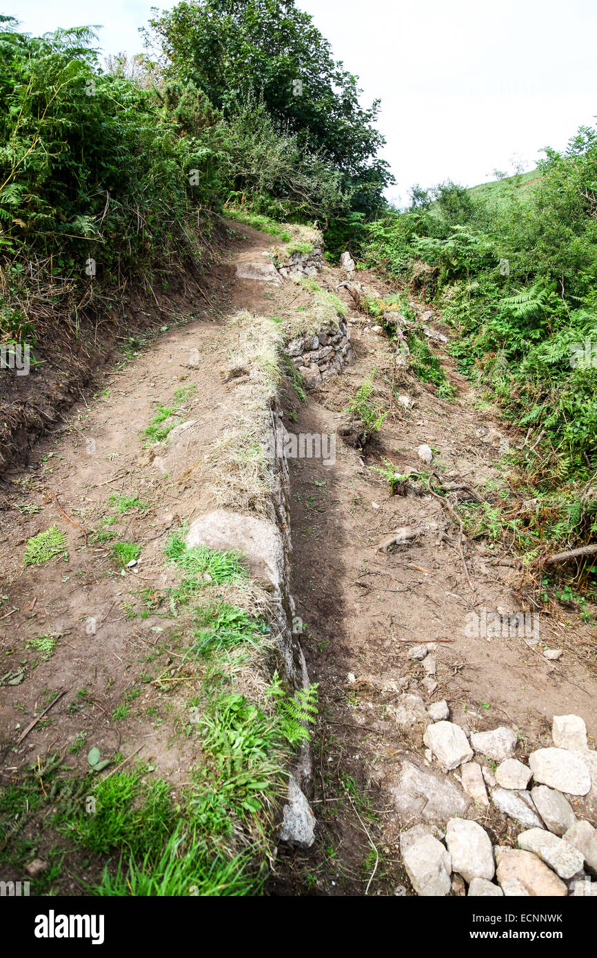 An eroded footpath being repaired with granite setts at Zennor Cornwall England UK - Stock Image