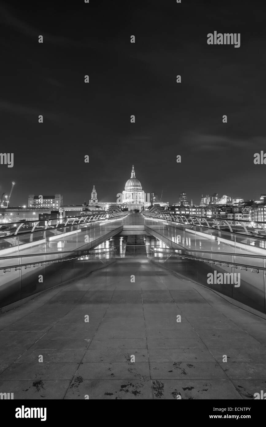 St Paul's Cathedral in London at night viewed from across the Millennium Bridge in Black and White - Stock Image