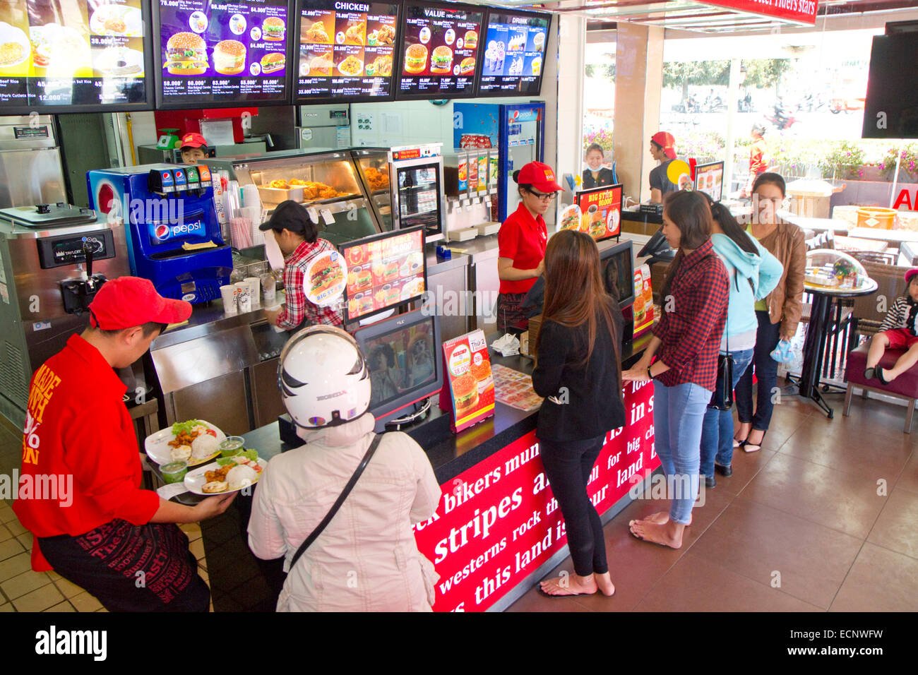 Interior of a Lotteria fast food restaurant in Da Lat, Vietnam. - Stock Image
