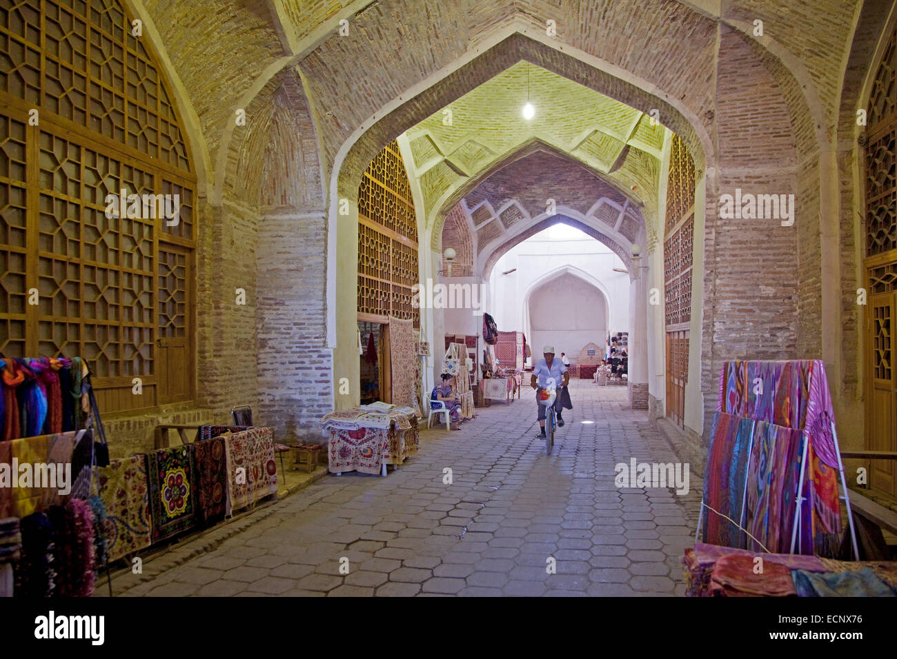 Carpets for sale in the old indoor market of the historic Silk Road town Bukhara / Buxoro, Uzbekistan - Stock Image