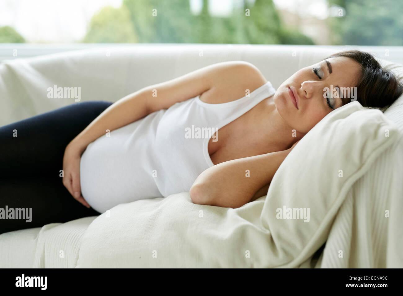 Pregnant woman sleeping - Stock Image