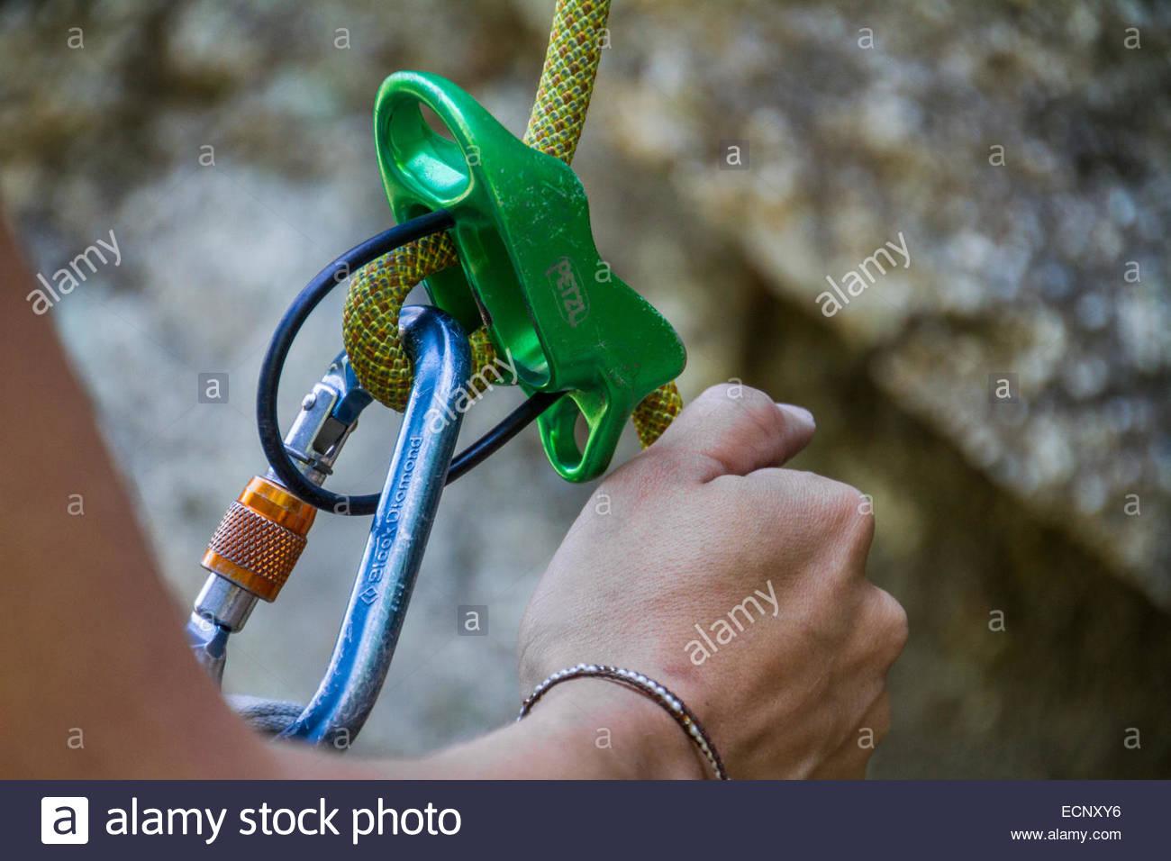 Close-up of woman's hand adjusting climbing harness - USA - Colorado - Stock Image