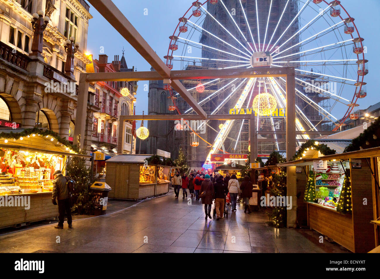 The big wheel and stalls at the Ghent Christmas Market at dusk, Ghent, ( Gent ), Belgium, Europe - Stock Image