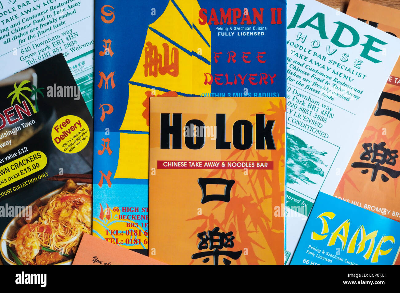 A selection of junk mail leaflets delivered door to door from Chinese take away restaurants. - Stock Image