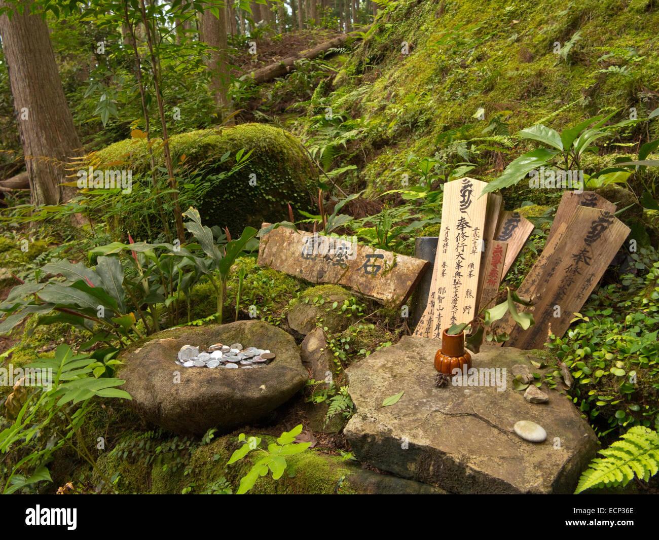 Offerings at shirine along the Kumano Kodo Pilgrimage Route near Waroda-ishe Rock, Kii Peninsula, Wakayama Prefecture, - Stock Image