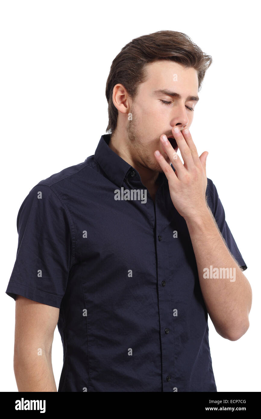 Tired man covering his mouth white yawning isolated on a white background - Stock Image