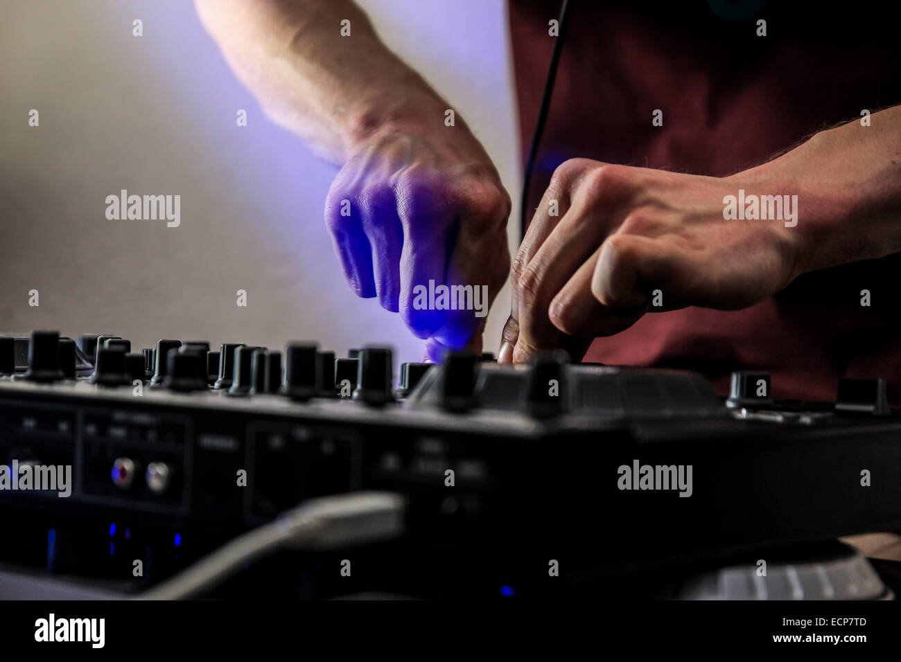 Abstract man Djing/Mixing on the Decks at a party/event - Stock Image