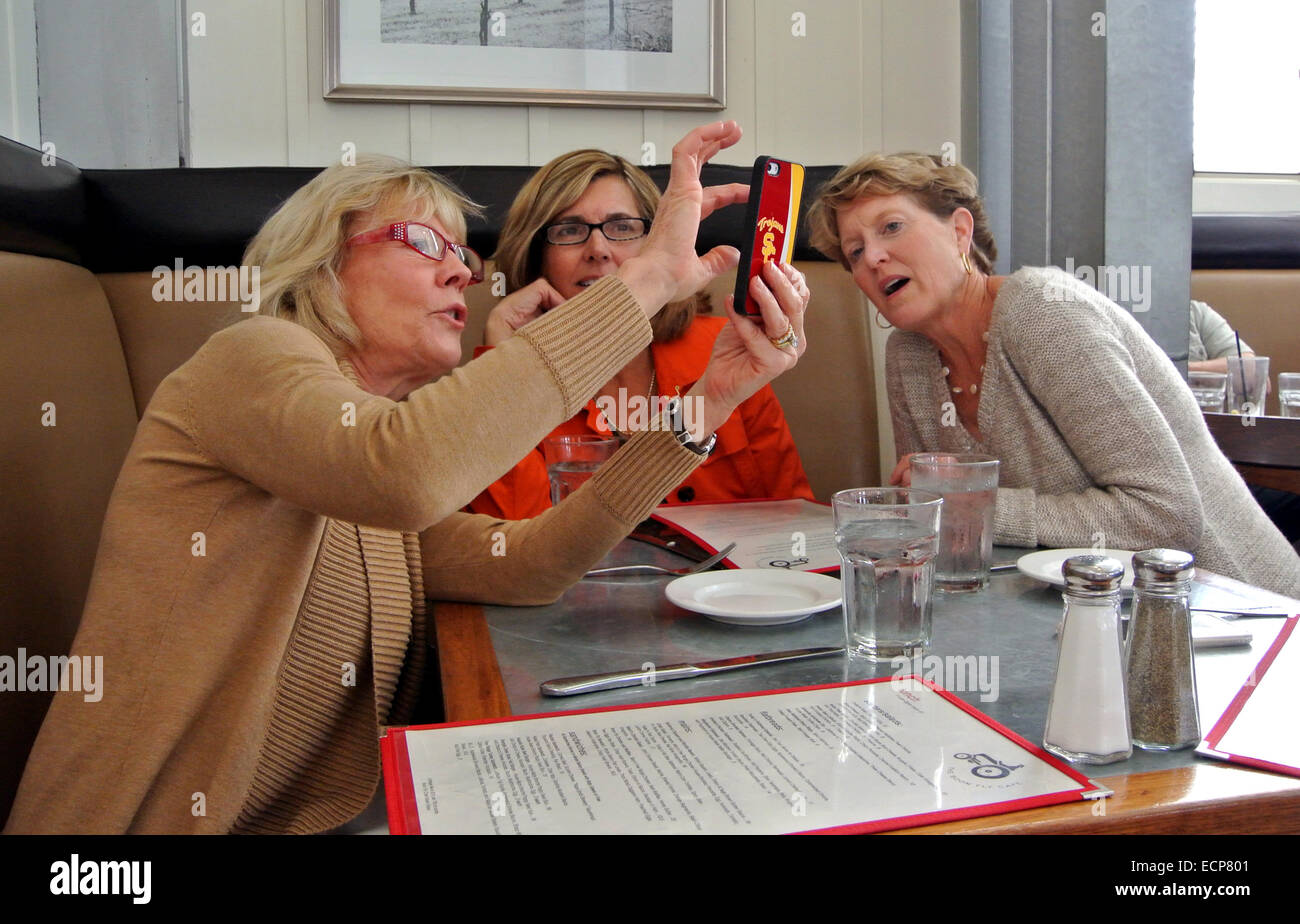 three friends take a selfie of themselves at restaurant cafe in Sonoma County Stock Photo
