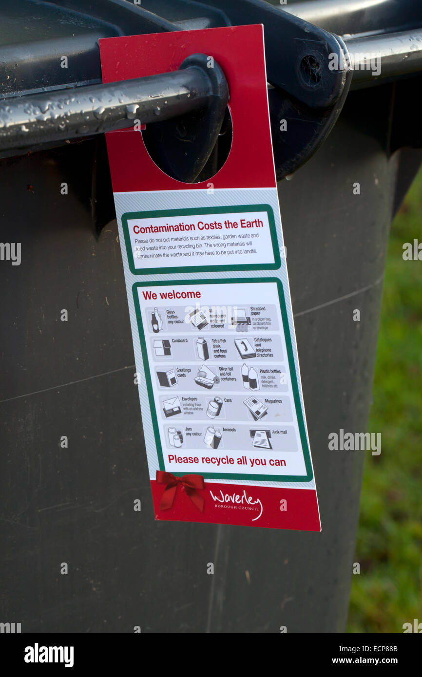 Contamination costs the earth notice on a wheelie bin - Stock Image