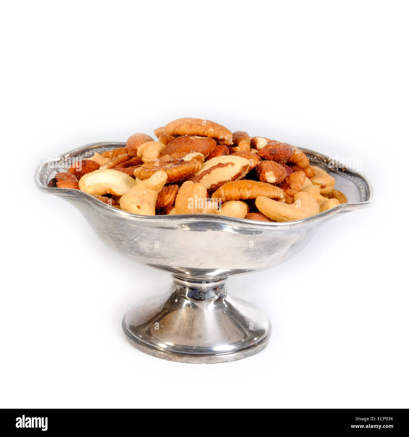 Bowl of salted mixed nuts snack finger food - Stock Image