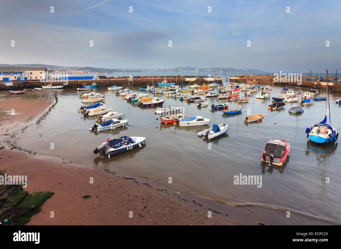 Boats in Paignton Harbour captured shortly before sunset. - Stock Image