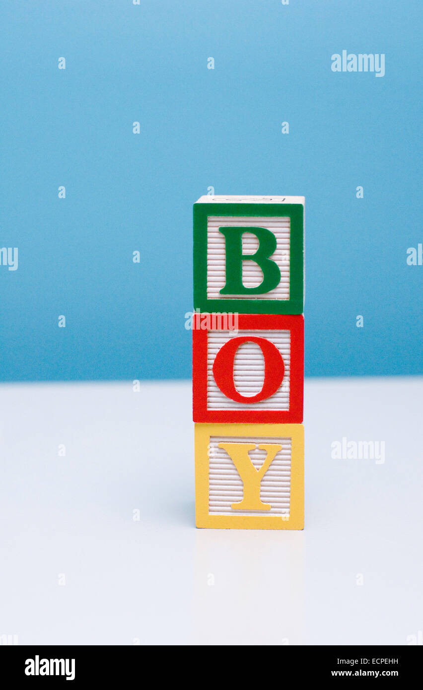 Building blocks for a child stacked to read BOY Stock Photo