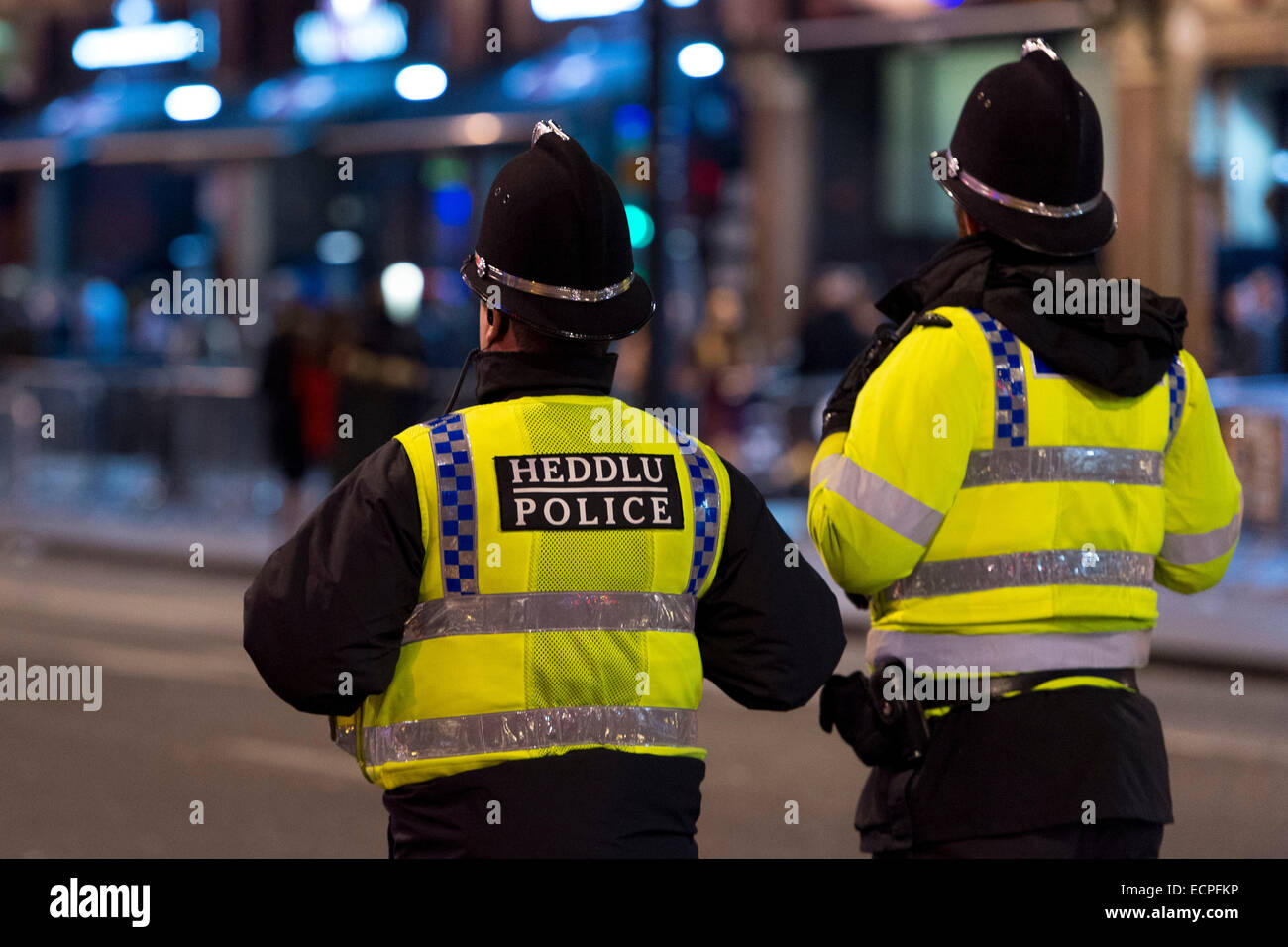 Police officers on patrol in Cardiff City centre at night. Stock Photo